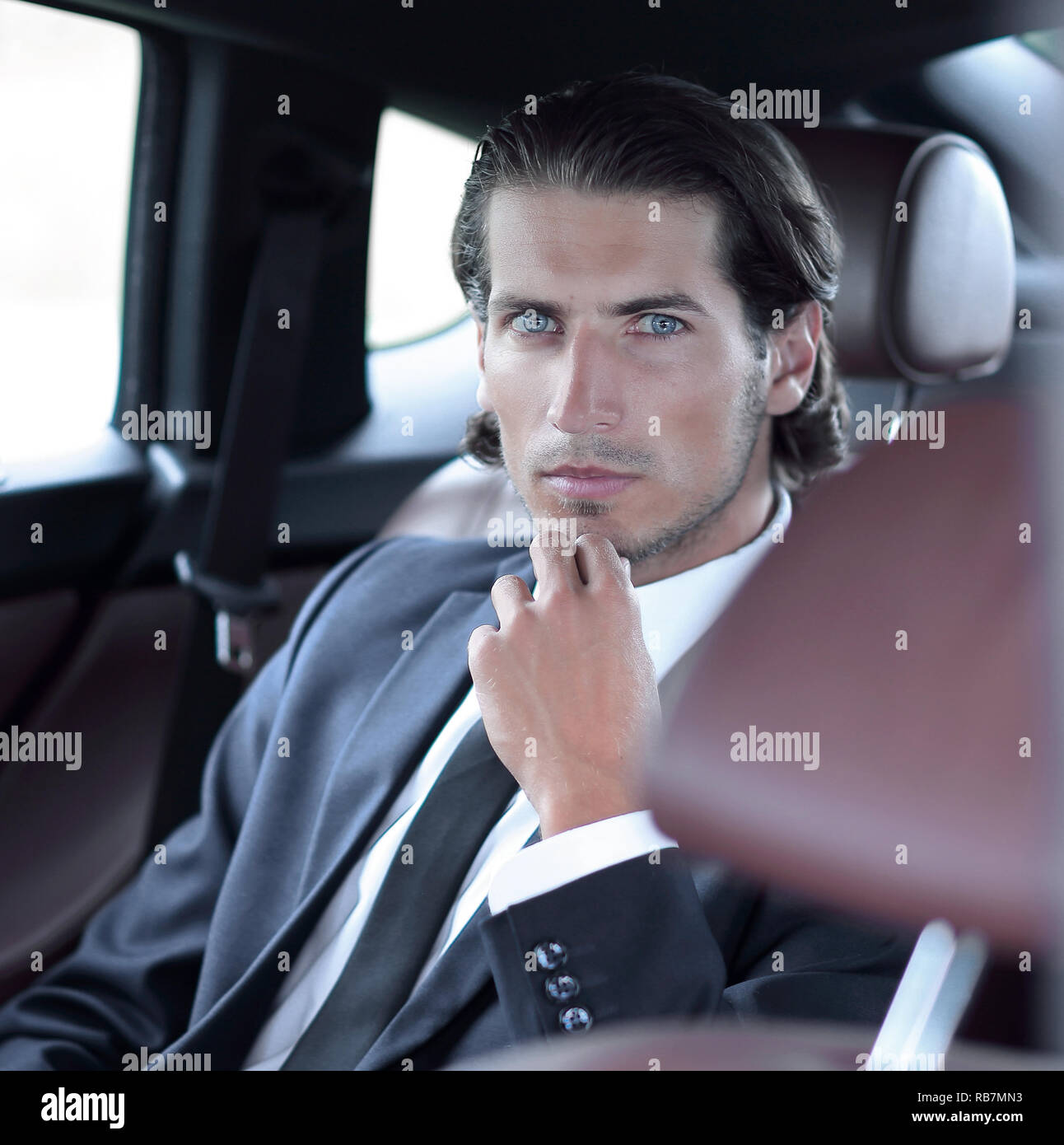 businessman sitting in a comfortable car Stock Photo