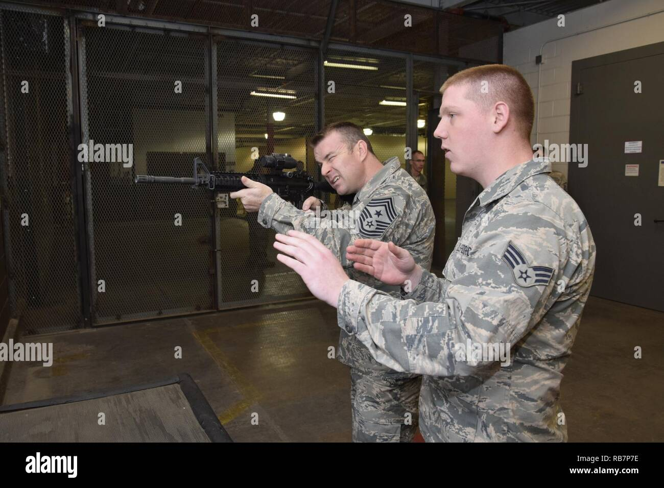 Air Force Sustainment Center Command Chief Master Sgt Gary S Sharp Holds An M4 Rifle While