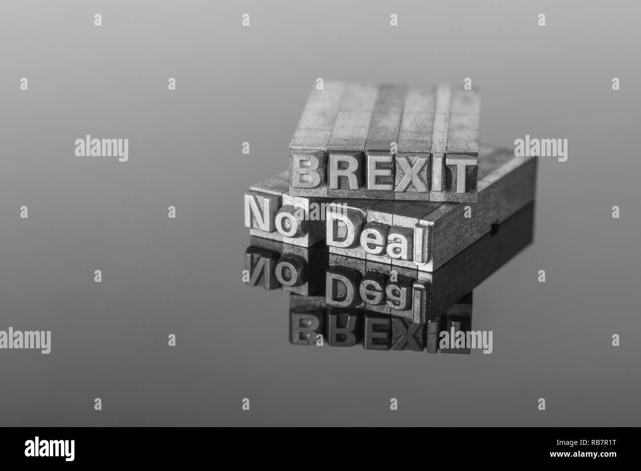 Brexit 'No Deal' spelled out in printer's typeface on a reflective black surface. Metaphor for the UK's Brexit endgame and No Deal scenario. See Notes - Stock Image