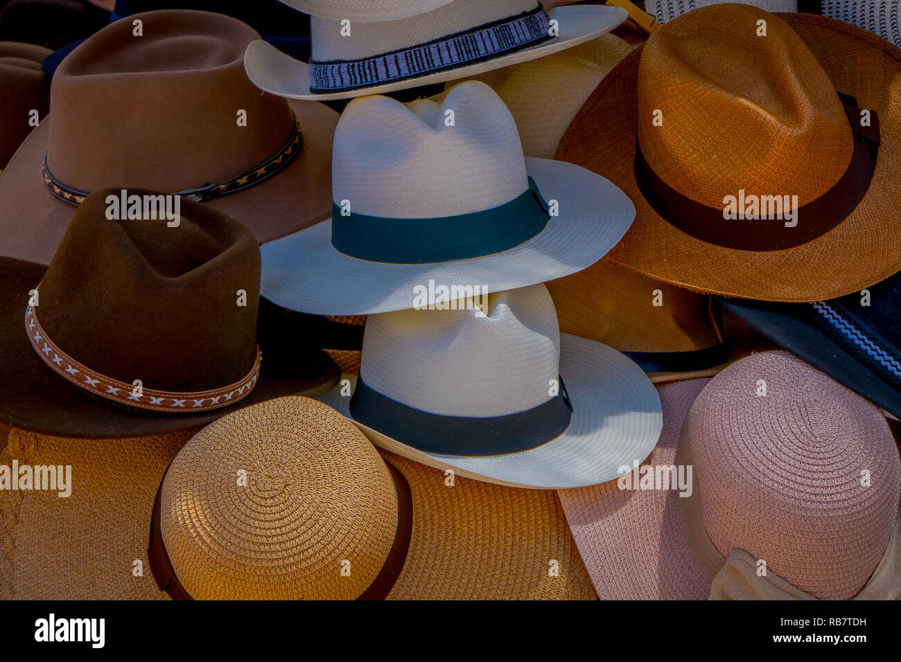 6ce362d2317db Outdoor view of market stall with panama hats in street market in Otavalo