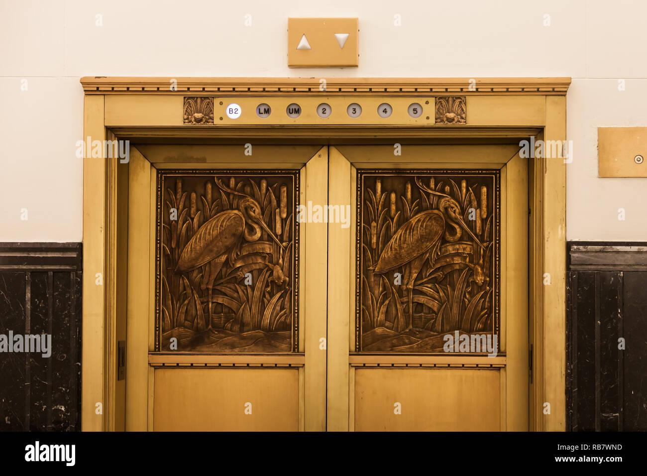 Brass elevator doors in a heritage building - Stock Image