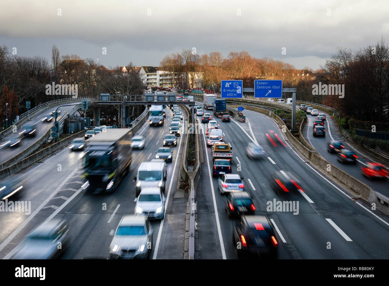 Essen, North Rhine-Westphalia, Ruhr area, Germany - Blue environmental zone, motorway A40 at the evening traffic in the city centre of Essen, here on  - Stock Image