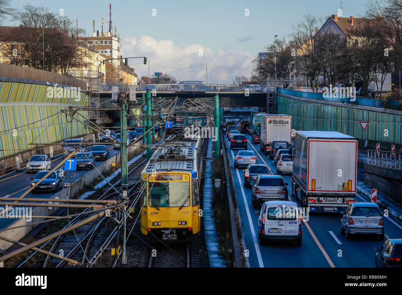 Essen, North Rhine-Westphalia, Ruhr area, Germany - Blue environmental zone, motorway A40 and subway line U18 at the evening traffic with view to the  - Stock Image