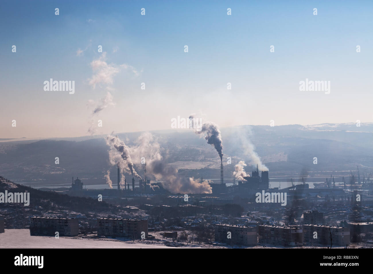 Chemical industry and working factory. Chimneys with smog in the sky. Air Pollution. - Stock Image