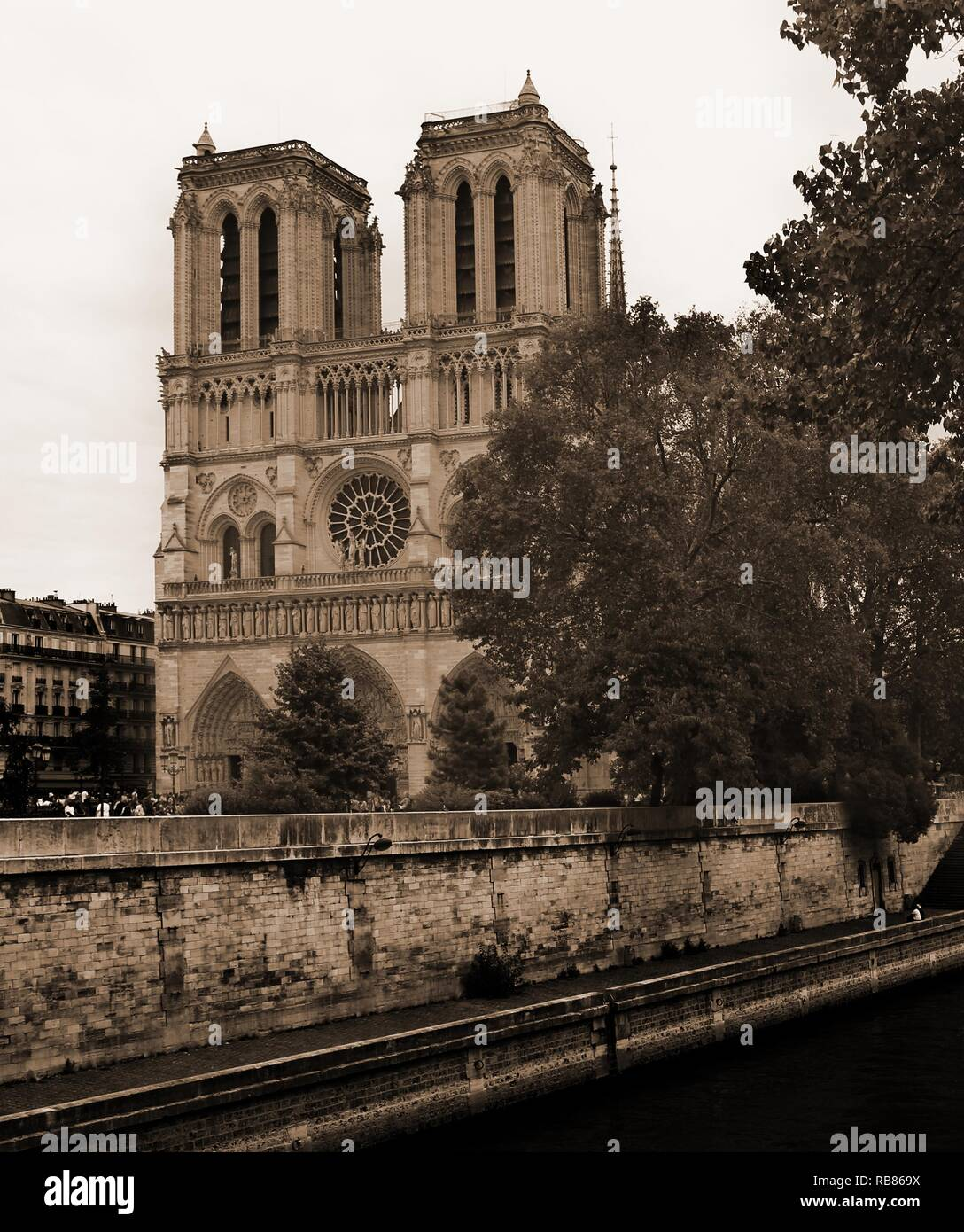 Ancient Basilica Of Notre Dame Of Paris And Seine River In