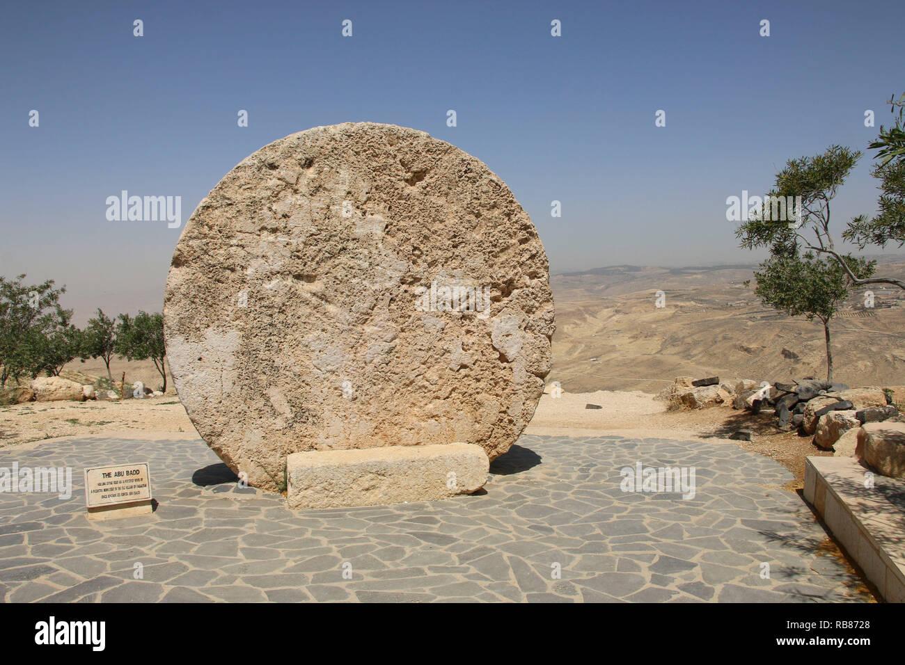 Abu badd - rolling stone used as door of Byzantine Monastery on Mount Nebo, Jordan - Stock Image