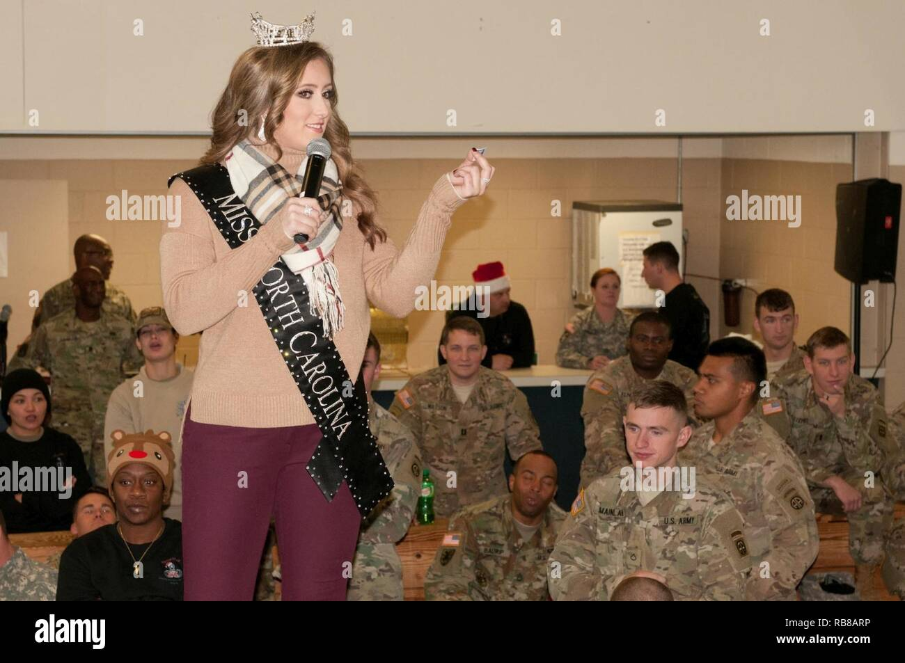 Miss North Carolina 2016, McKenzie Faggart, calls out numbers during the Operation Toy Drop lottery day jump selection. During lottery day of OTD, Soldiers can choose to bring a toy to donate to local children in need. - Stock Image