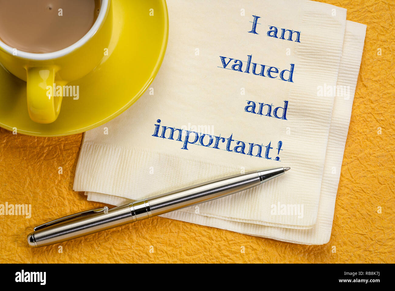 I am valued and important - handwriting on a napkin with a cup of coffee - Stock Image