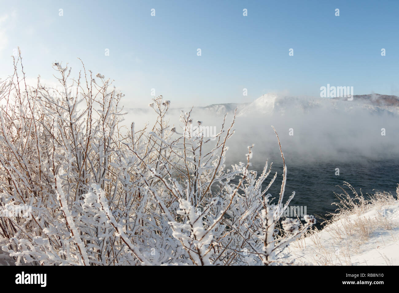 Baikal in winter is covered with water vapor by foggy steam in January. - Stock Image
