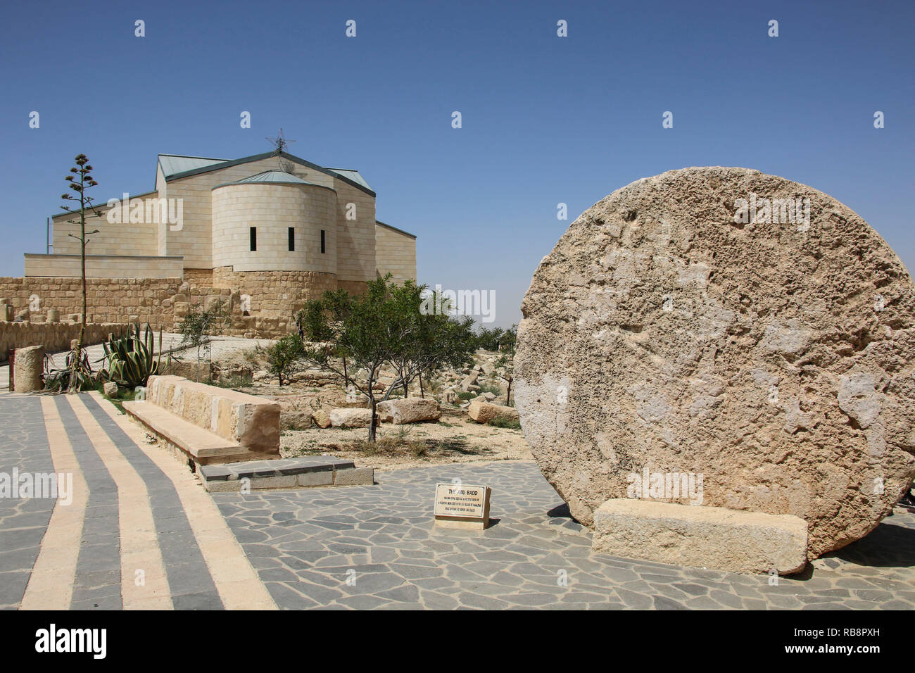 The Memorial church of Moses and Abu badd - rolling stone used as door of Byzantine Monastery on Mount Nebo, Jordan - Stock Image