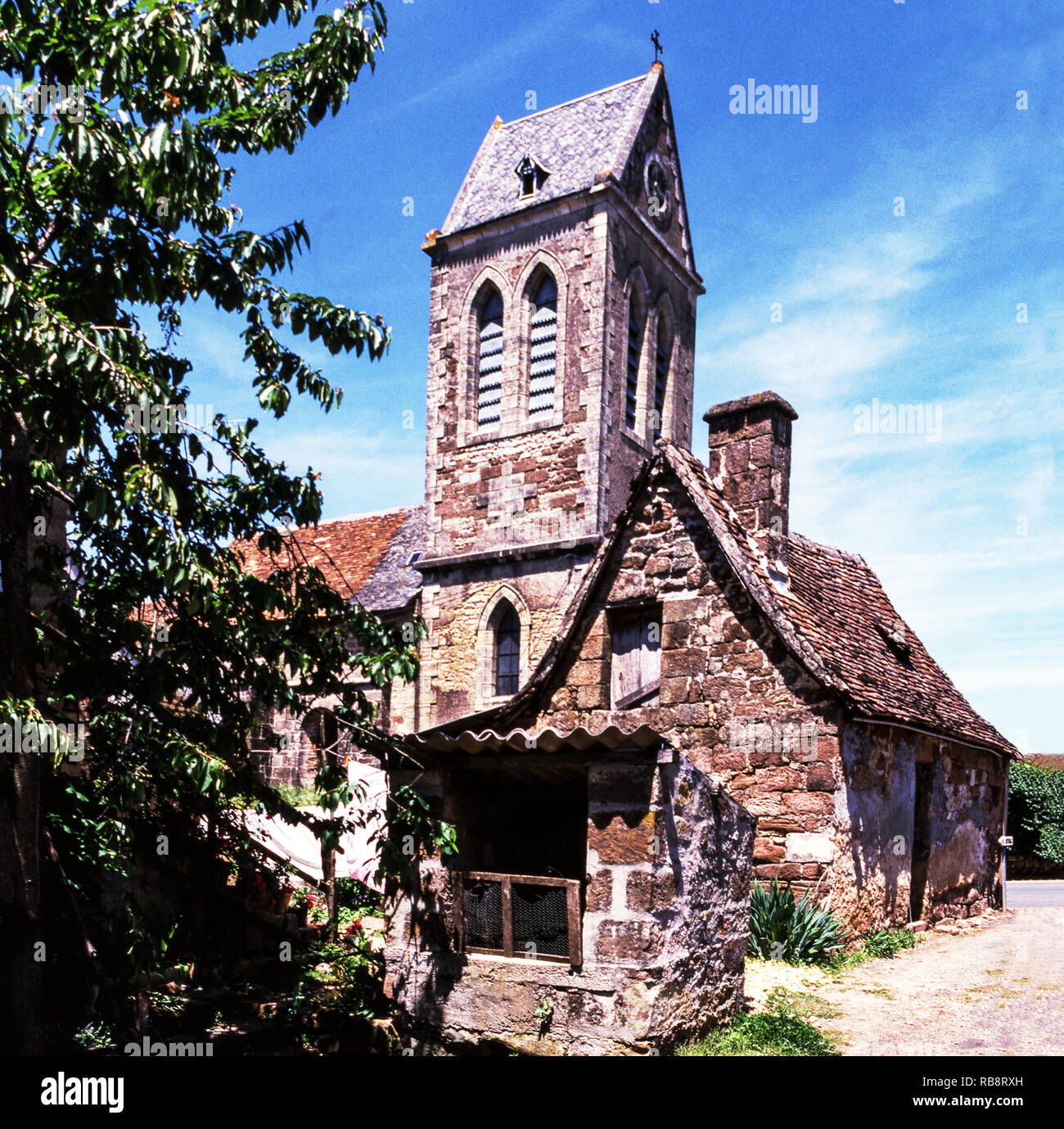 The village church of Louignac in the Correze Department.France. - Stock Image