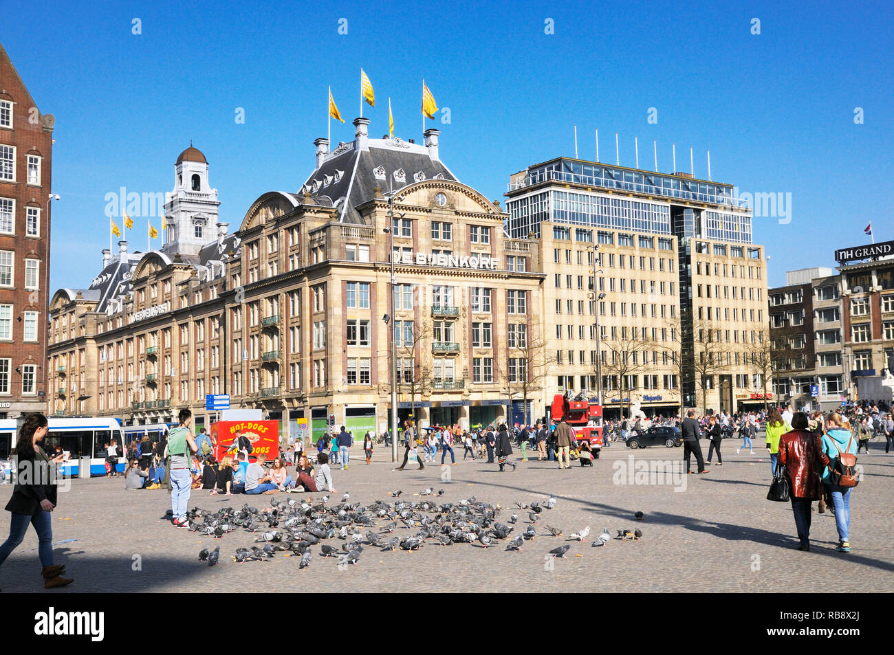 Dam Square and the flagship De Bijenkorf department store, Amsterdam, Netherlands - Stock Image