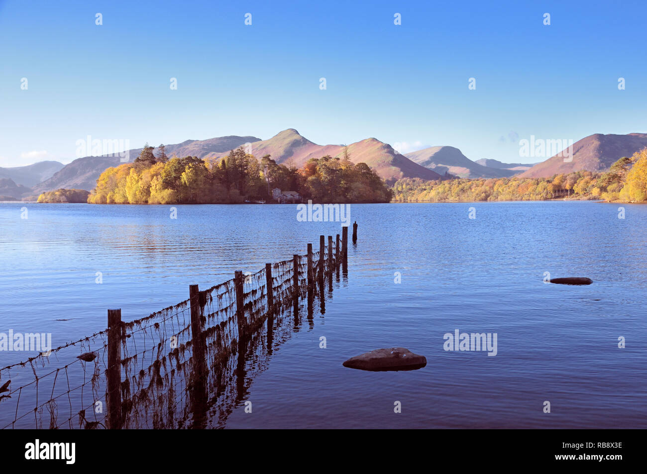 A view from the shores of Derwentwater towards Derwent Isle and Catbells, Lake District, England, UK - Stock Image