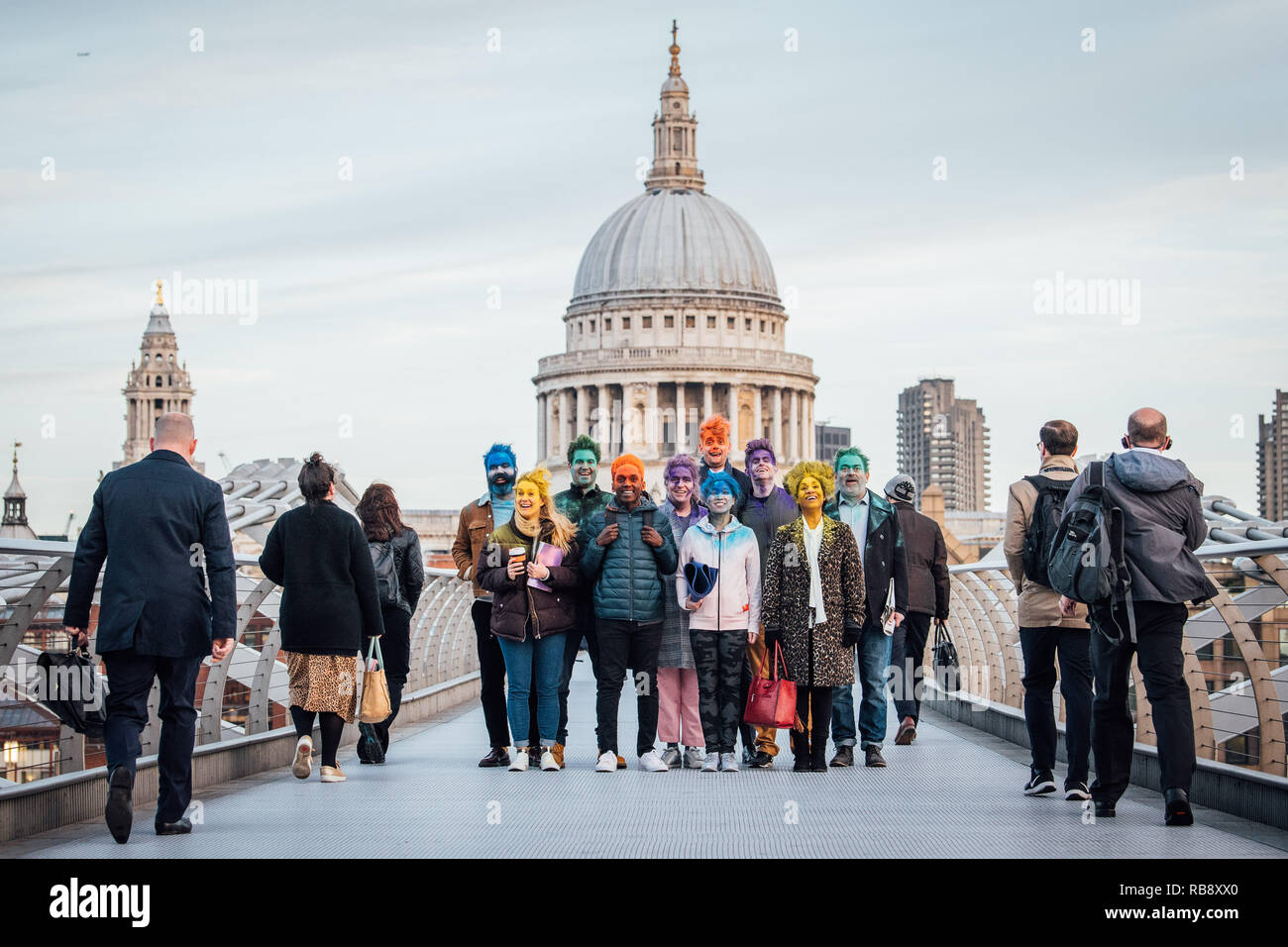 London commuters around the Waterloo area were greeted with a Mind-Blowing sight this morning when fellow commuters brightly coloured faces appeared across the city. - Stock Image