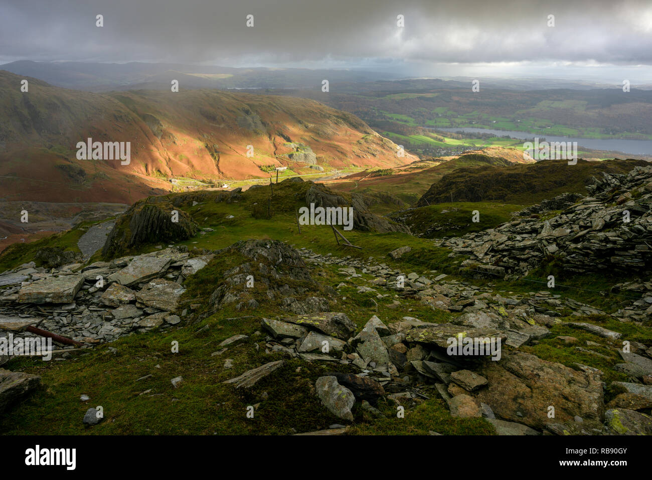 Saddlestone Quarry on the flank of The Old Man of Coniston with the Coppermines Valley beyond in the Lake District National Park, Cumbria, England. - Stock Image
