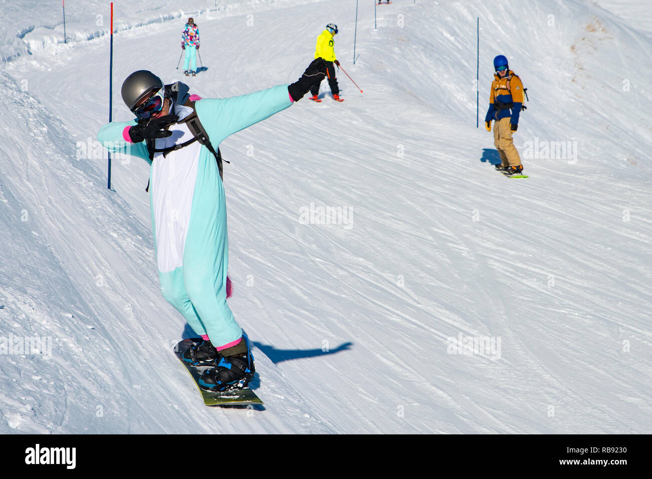 People enjoy snowboard for winter holiday in Alps area, Les Arcs 2000, Savoie, France, Europe - Stock Image