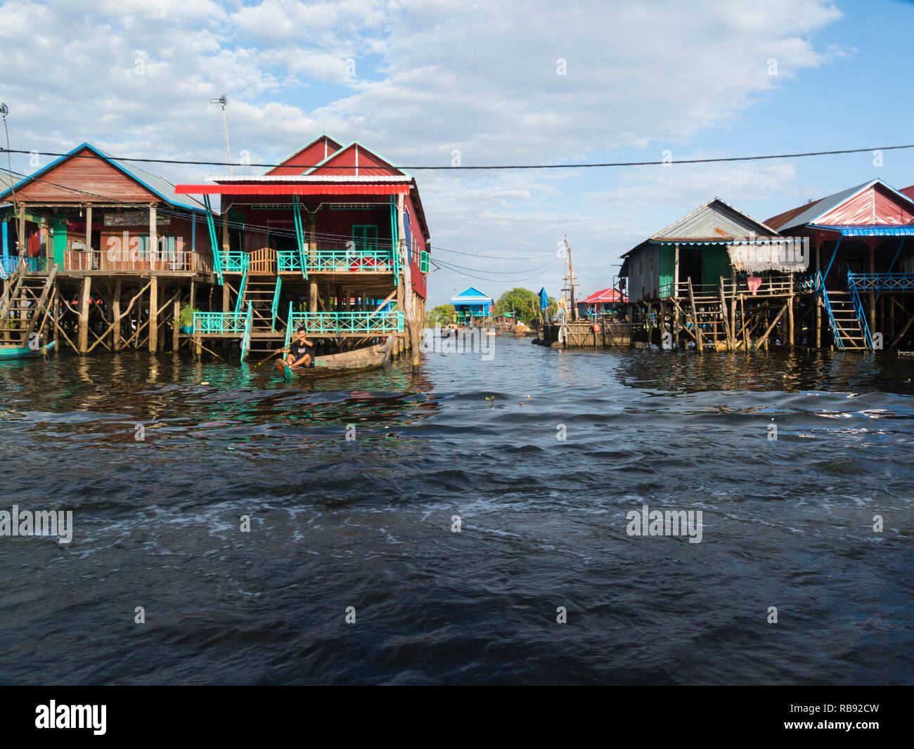 Stilted homes in Kampong Phluk floating village on Kampong Phluk RiverSiem Reap Cambodia Asia home to approximately 3000 predominately Khmer fishing p - Stock Image