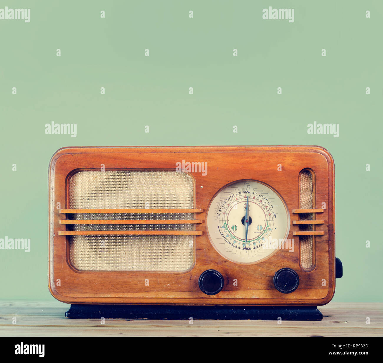 Old style vintage radio over retro mint background with copyspace design. - Stock Image