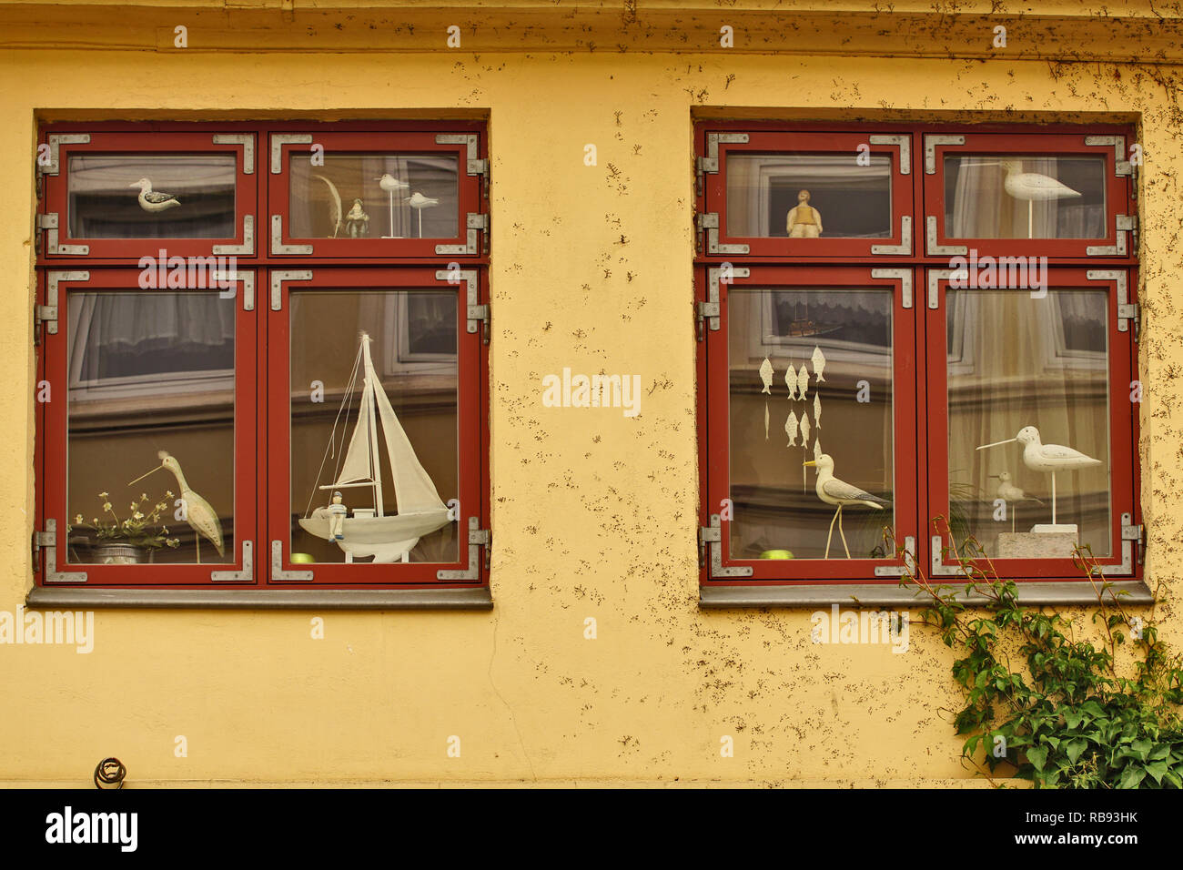two windows with maritime decoration - Stock Image