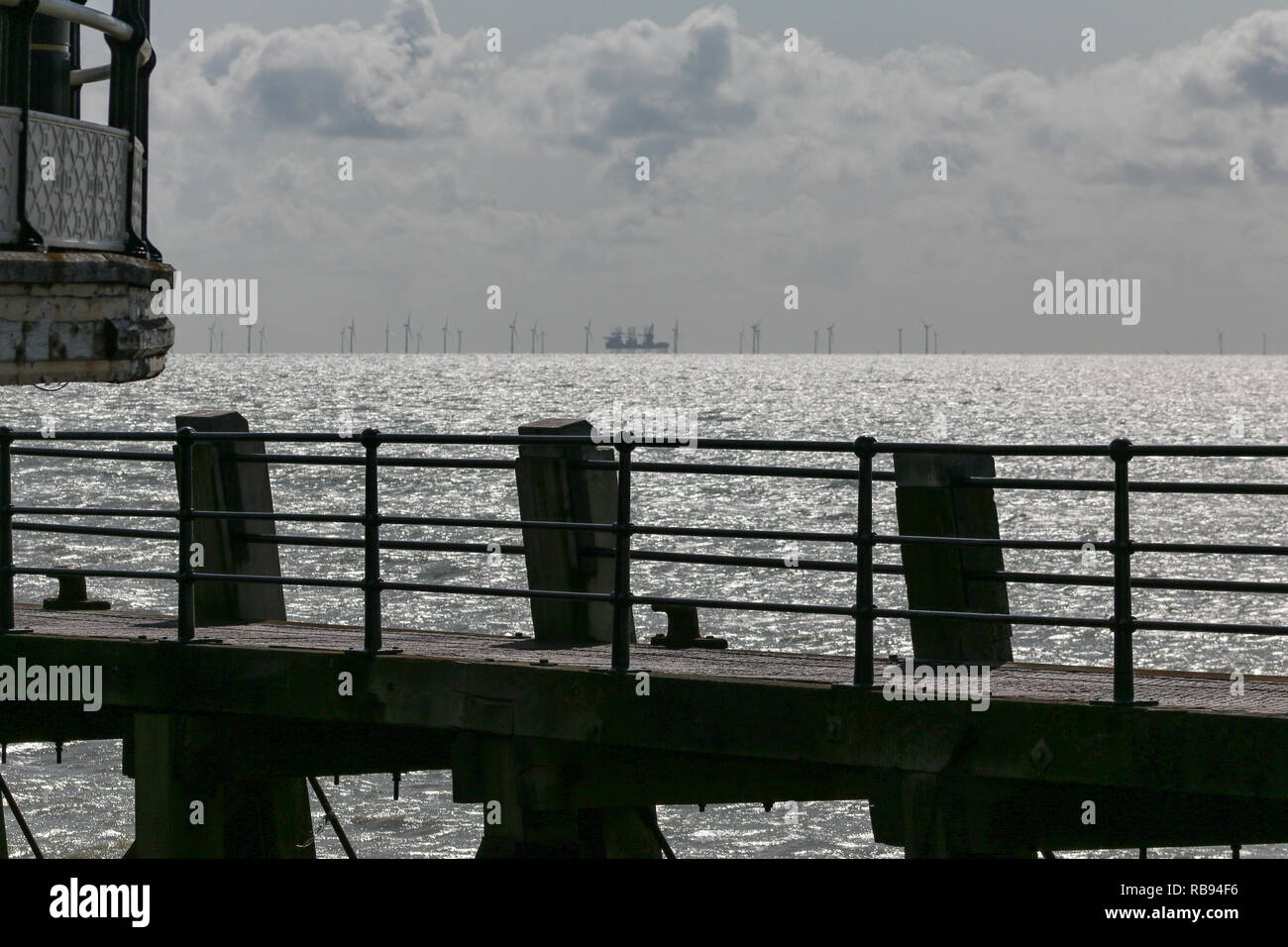 Looking out to see towards the Rampion wind farm from the end of the pier - Stock Image