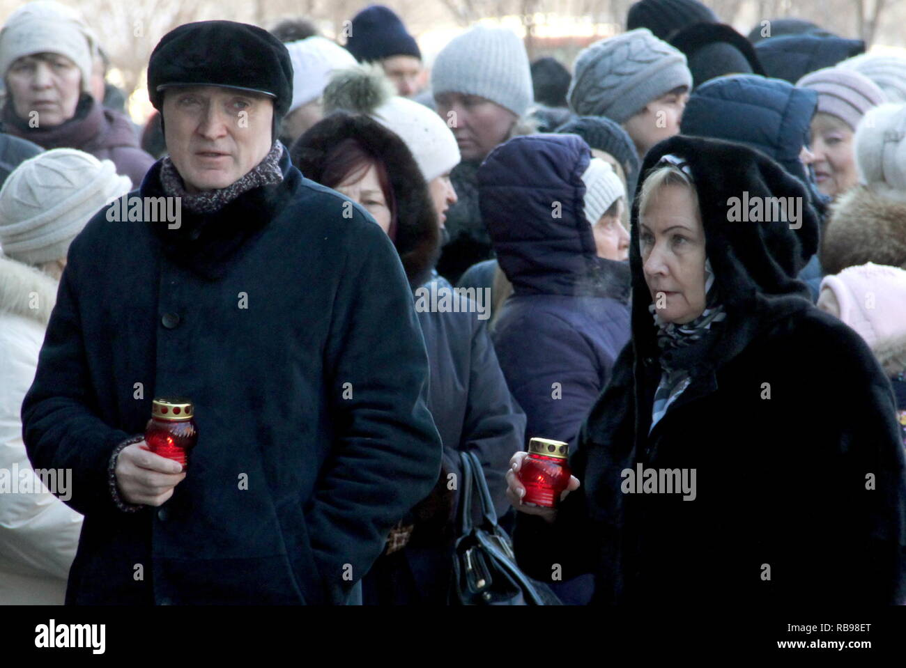 Magnitogorsk, Russia. 08th Jan, 2019. CHELYABINSK REGION, RUSSIA - JANUARY 8, 2019: Chelyabinsk Region Governor Boris Dubrovsky with his wife Vera (front) at a memorial religious service for the Magnitogorsk gas explosion victims; on December 31, 2018, at 4:00am, a domestic gas explosion caused a partial collapse of the residential building at 164 Karla Marksa Avenue killing 39 people. Ilya Moskovets/TASS Credit: ITAR-TASS News Agency/Alamy Live News - Stock Image