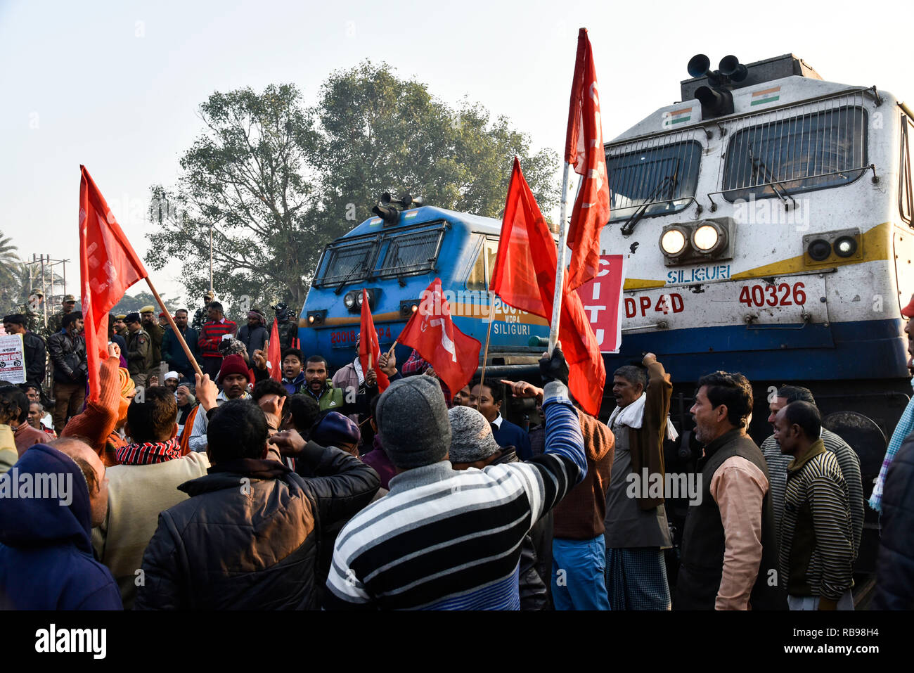 Centre of Indian Trade Unions (CITU) nationwide strike. Guwahati, Assam, India. Jan 8, 2019. Activists from the Centre of Indian Trade Unions (CITU), which is politically aligned with the Communist Party of India (Marxist), block trains at Guwahati Railway Station during a nationwide strike in Guwahati, nearly 200 million Indian workers went on a two-day nationwide strike January 8 to protest 'anti-labour policies' of Prime Minister Narendra Modi's government, triggering sporadic violence in some cities. PHOTO: DAVID TALUKDAR. Credit: David Talukdar/Alamy Live News - Stock Image