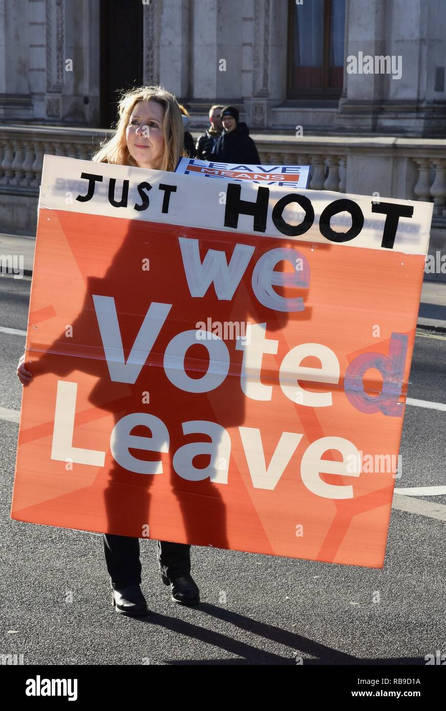London, UK. 8th Jan 2019. A Brexiteer holding a 'We voted leave' placard appeals to motorists to hoot their support. Outside 10 Downing Street, Whitehall,London.UK Credit: michael melia/Alamy Live News - Stock Image