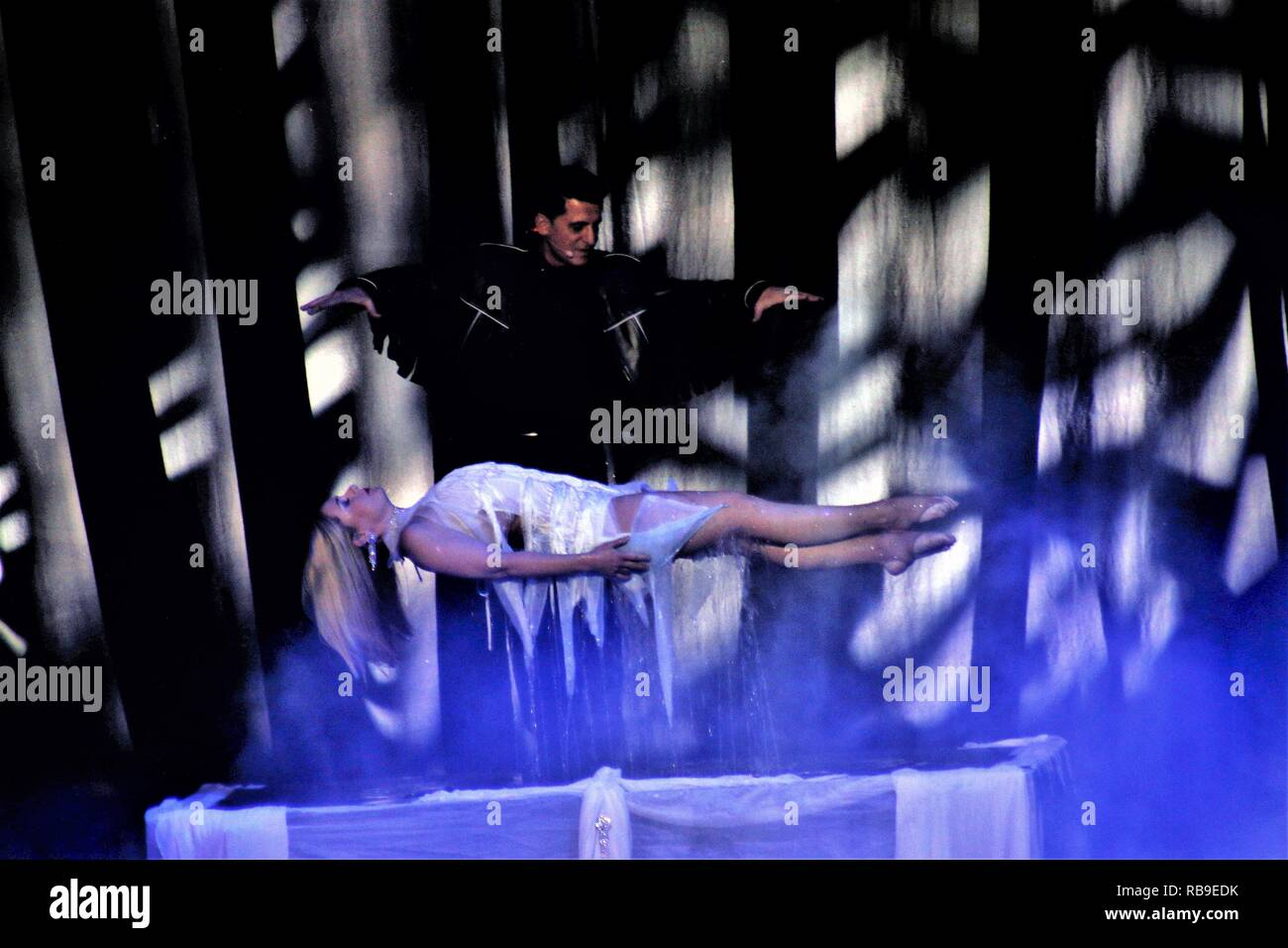 Athens, Greece. 6th Jan, 2019. A magician seen presenting the floating woman during the magical show.The best and the most awarded Las Vegas magicians presented figures that stunned between realism and illusion. Offering spectators magic humor and strong emotions at the Christmas Magic Festival in Athens. Credit: Helen Paroglou/SOPA Images/ZUMA Wire/Alamy Live News - Stock Image