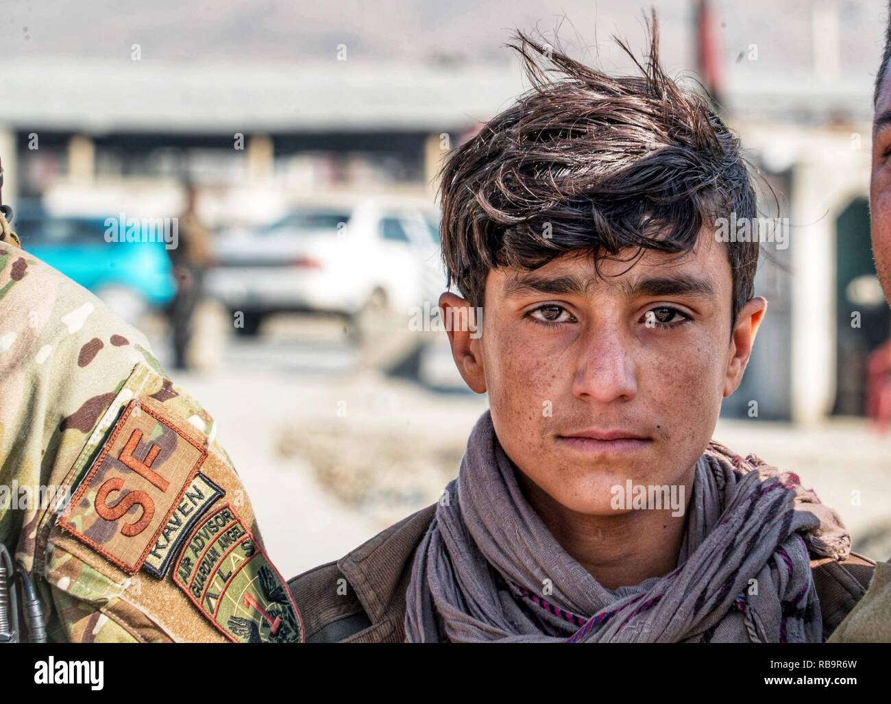 An Afghan boy greets U S  Air Force Security Forces members
