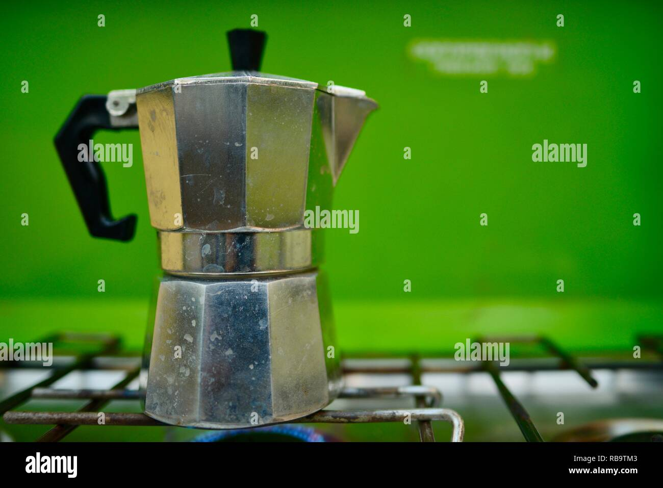 A Stovetop Espresso Maker on and old style camping gas stove, Smalleys Beach Camp Ground, Cape Hillsborough National Park, Qld, Australia - Stock Image