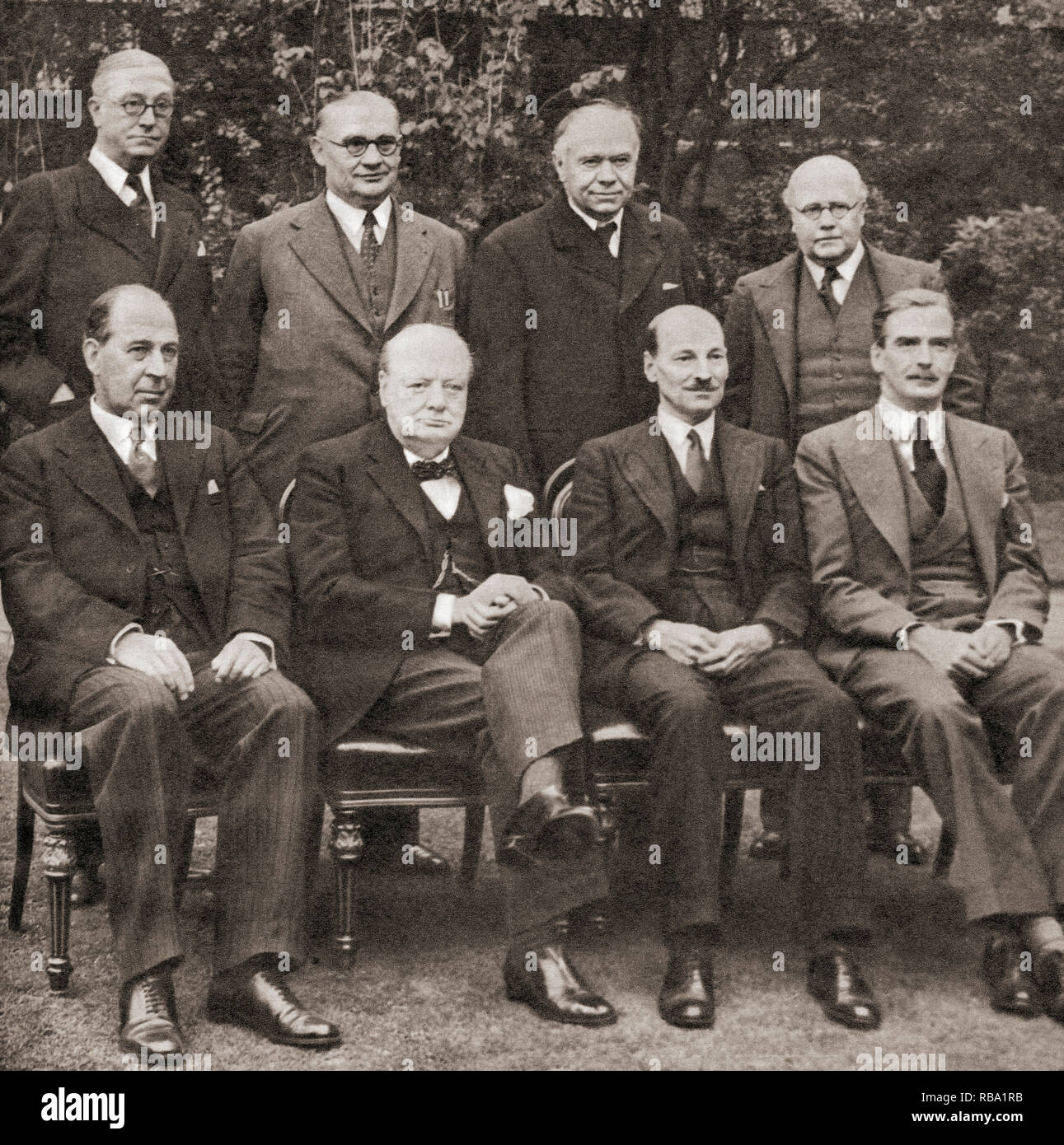 Mr. Churchill's War Cabinet in the spring of 1941. Back row, left to right, Mr. Arthur Greenwood, Minister without Portfolio, Mr. Ernest Bevin, Minister of Labour, Lord Beaverbrook, Minister of Aircraft Production, Sir Kingsley Wood, Chancellor of the Exchequer.  Front row, left to right, Sir John Anderson, Lord President of the Council, Mr. Winston Churchill, Prime Minister, Mr. Clement Attlee, Lord Privy Seal, Mr. Anthony Eden, Foreign Secretary.  Sir Winston Leonard Spencer-Churchill, 1874 –1965. British politician, statesman, army officer, and writer, who was Prime Minister of th - Stock Image
