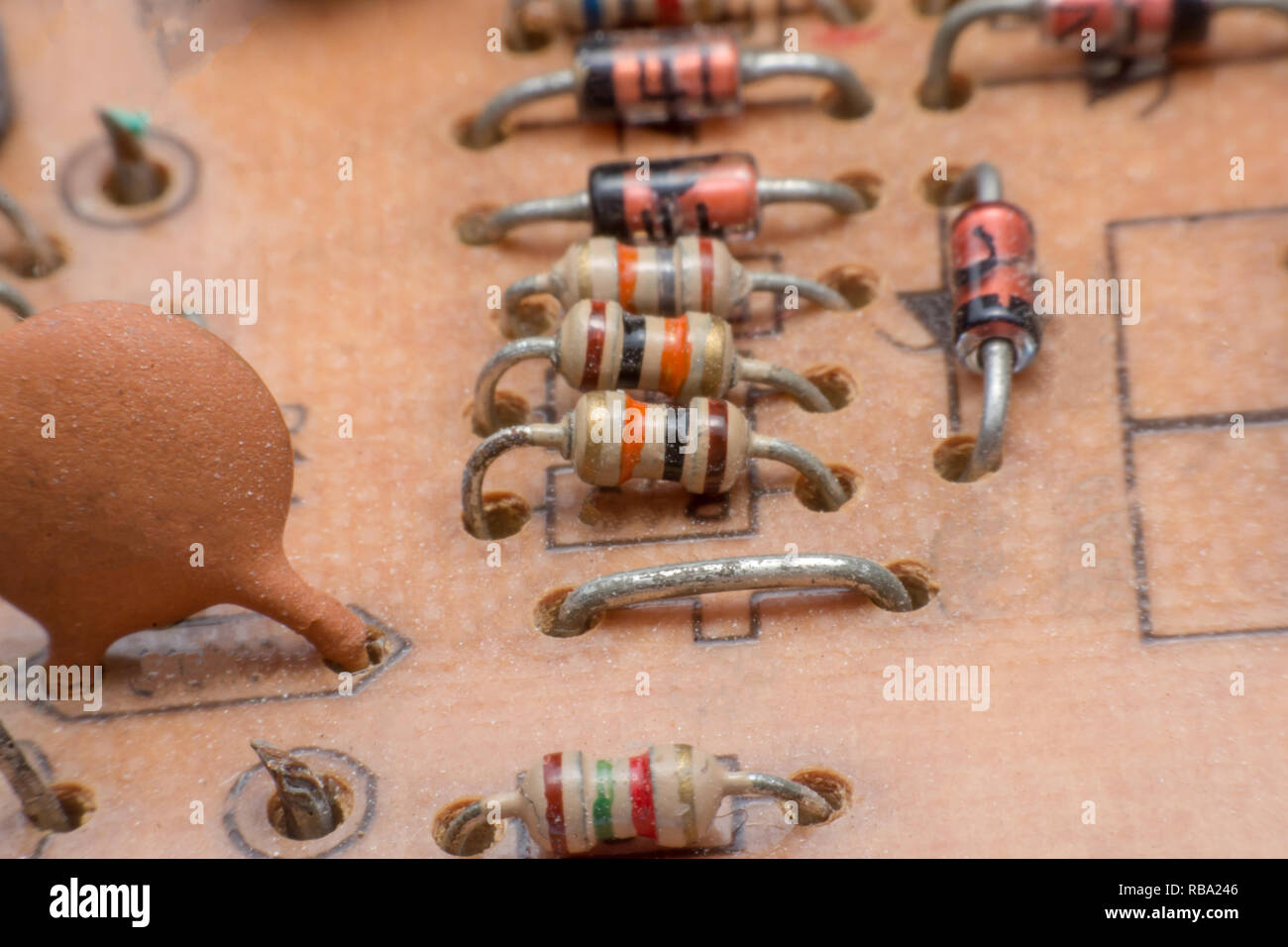 Close up electronic hardware Resistor and condensers assembly on the circuit board - Stock Image