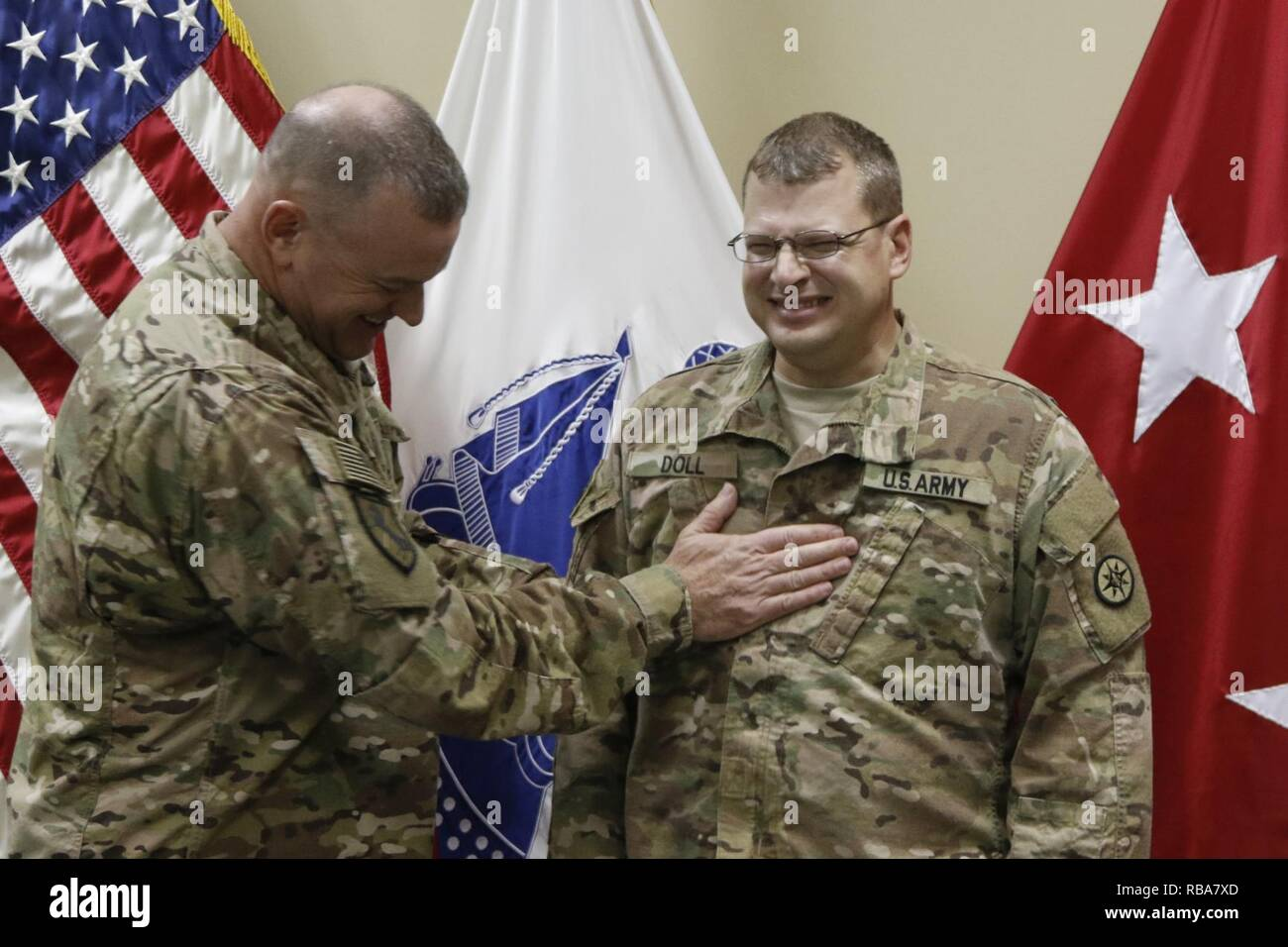 Brig. Gen. Robert D. Harter, 316th Sustainment Command (Expeditionary) commanding general, places the rank of Major on Phillip Doll during a promotion ceremony at Camp Arifjan, Kuwait, Dec. 31, 2016. - Stock Image