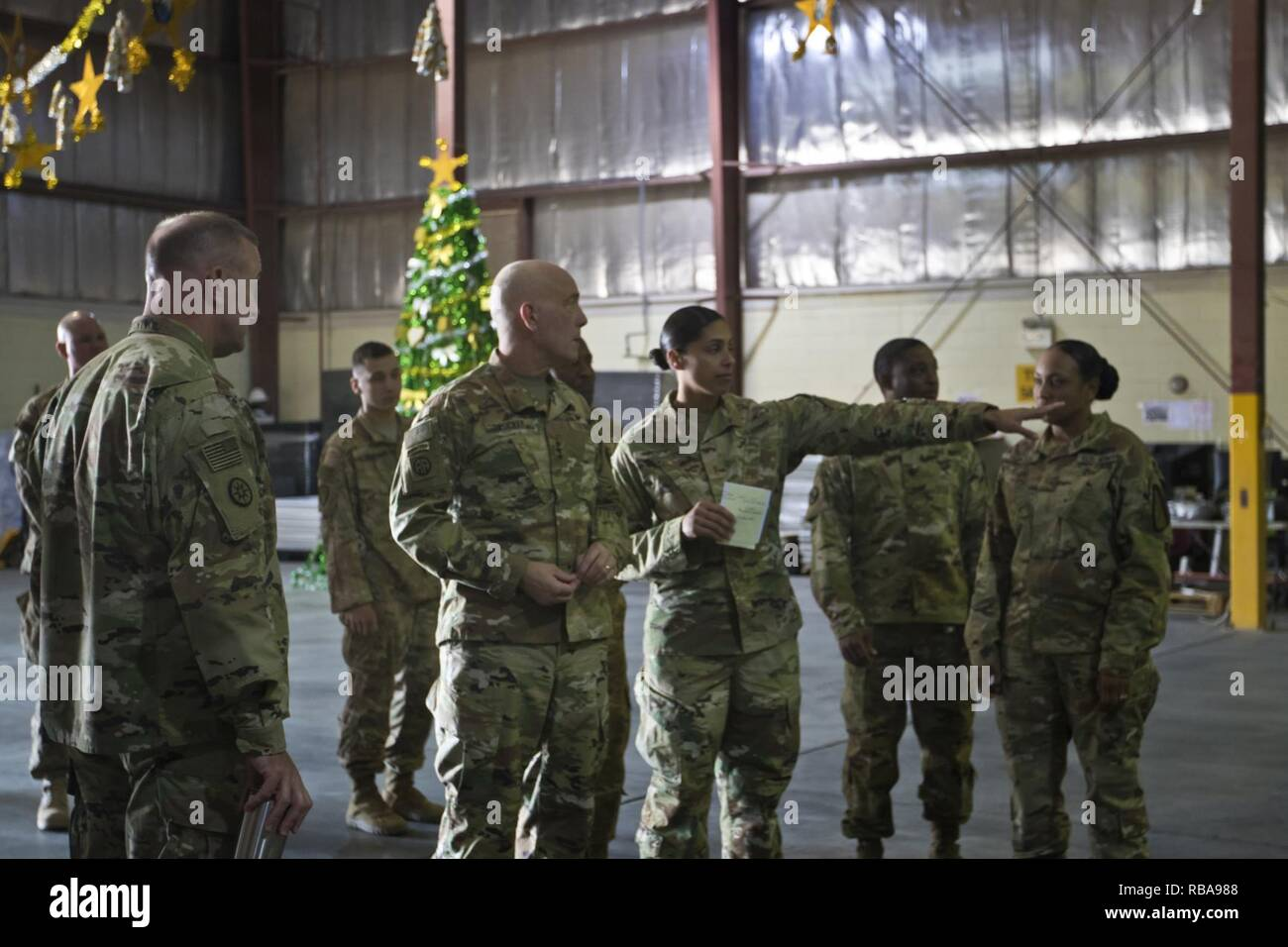 U.S. Army Reserve Commanding General, Lt. Gen. Charles D. Luckey, tours the Iraq Train and Equipment Fund (ITEF) warehouse at Camp Arifjan, Kuwait, Jan. 4, 2017. - Stock Image