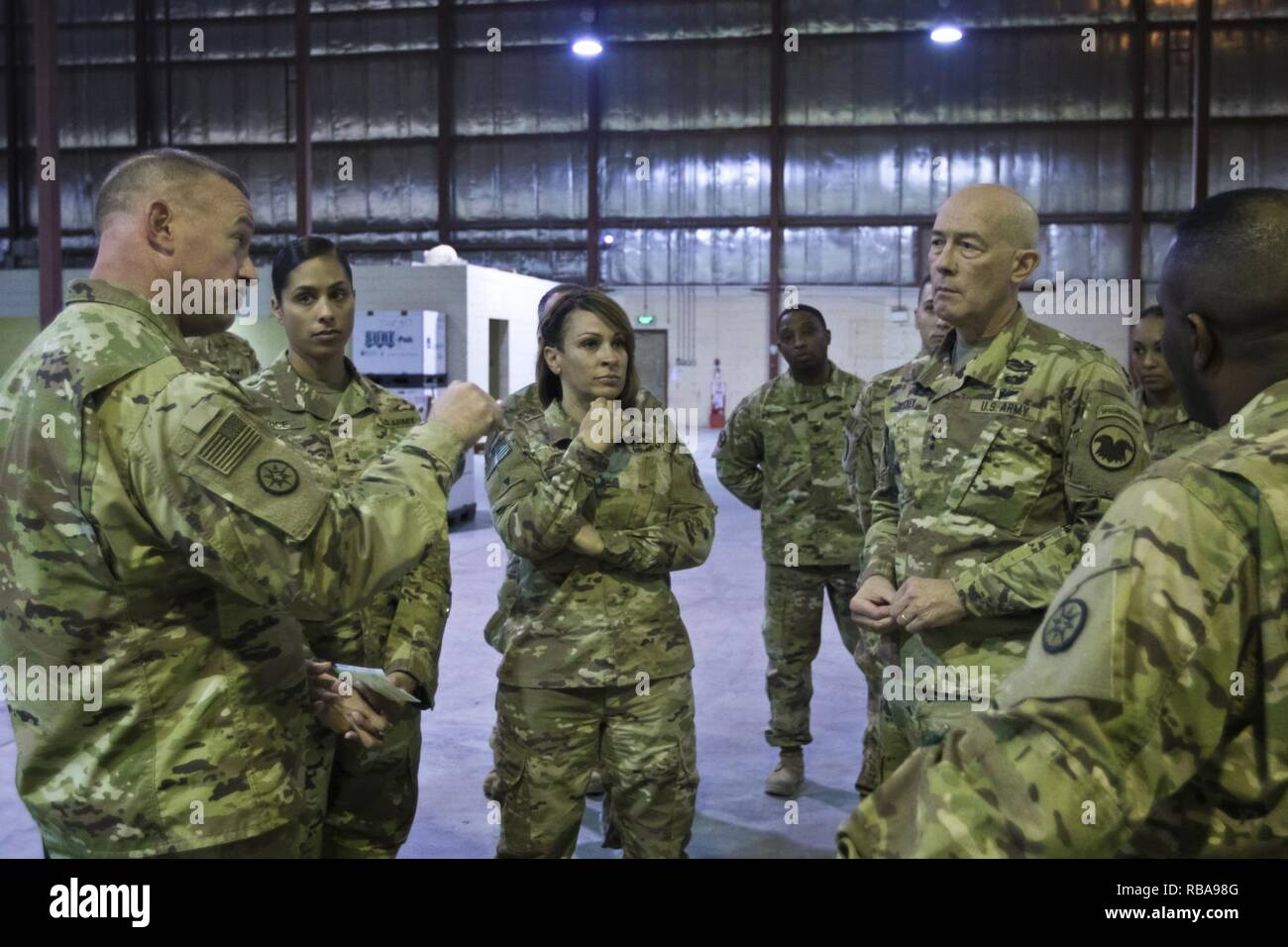 Brig. Gen. Robert D. Harter, commanding general of the 316th Sustainment Command (Expeditionary), (left), explains the process of how equipment is moved through out the U.S. Central Command (USCENTCOM) Area of Responsibility (AOR) to U.S. Army Reserve Commanding General, Lt. Gen. Charles D. Luckey, (right), during a tour the Iraq Train and Equipment Fund (ITEF) warehouse at Camp Arifjan, Kuwait, Jan. 4, 2017. - Stock Image