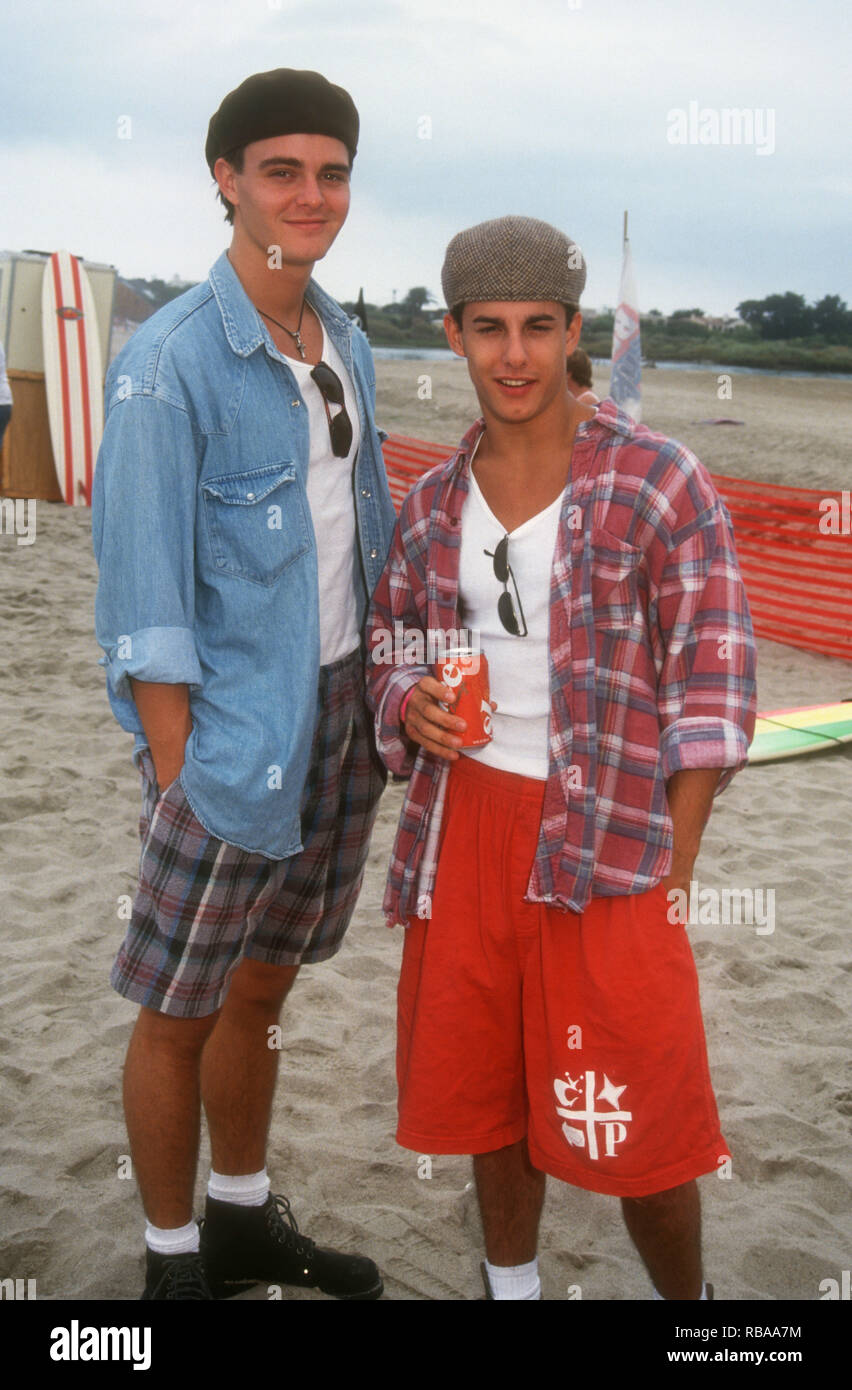 MALIBU, CA - JULY 25: (L-R) Actor Brentley Gore and actor Michael Cade attend 3rd Annual Celebrity Surfing Competition event on July 25, 1993 at Malibu Surfrider Beach in Malibu, California. Photo by Barry King/Alamy Stock Photo - Stock Image