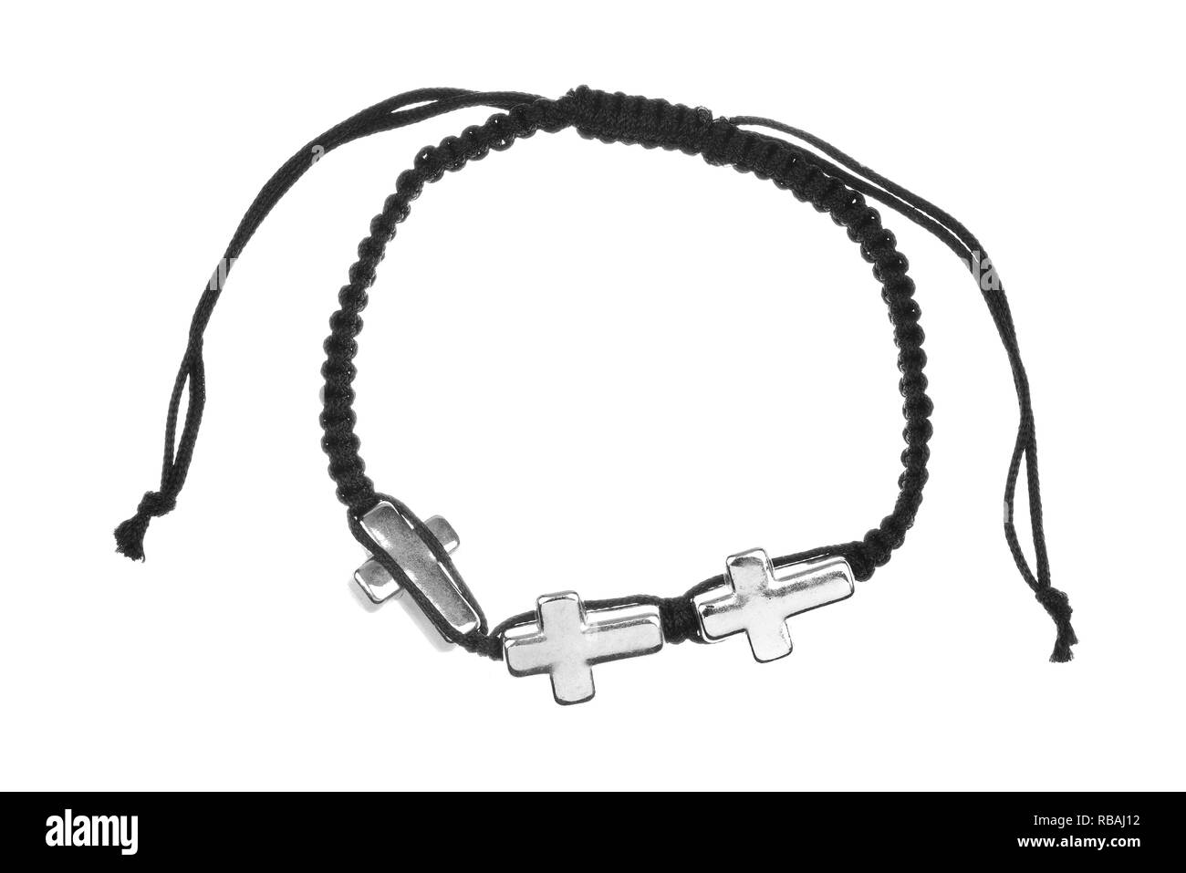 Black textile bracelet with three metallic crosses, isolated on white background - Stock Image