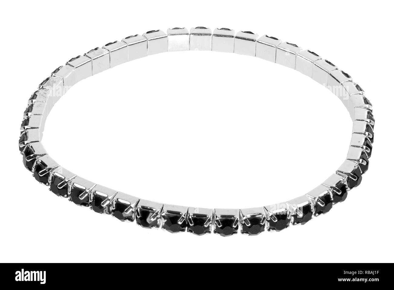 Silver bracelet with black precious stones and gems, isolated on white background - Stock Image