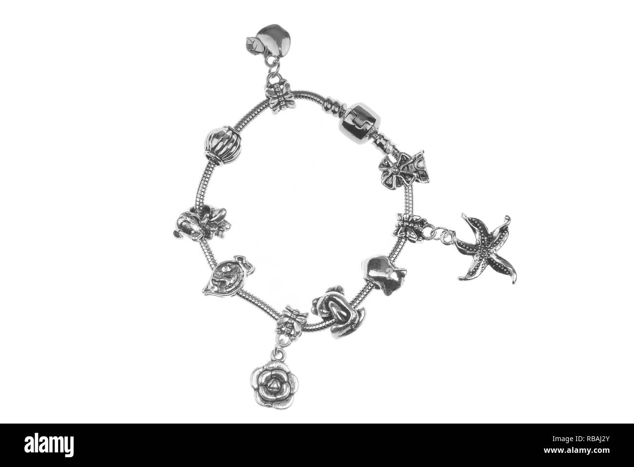 Small silver charm bracelet with many charms isolated on white background - Stock Image