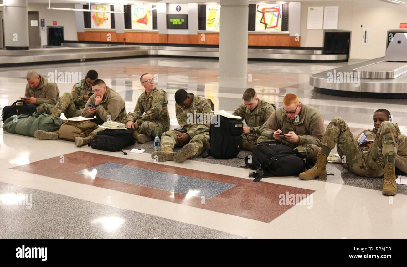 Ordnance advanced individual training (AIT) Soldiers wait to check into their flights from the Richmond International Airport Dec. 20, 2018.. The node processed 2,000 Fort Lee, Va., Soldiers who were flying home for the holidays. The brigade processed more than 4,200 Soldiers leaving via POV, air, bus and train. Each year during the Christmas and New Year holiday season, U.S. Army Combined Arms Support Command AIT schools conduct HBL to give military students and cadre downtime. - Stock Image