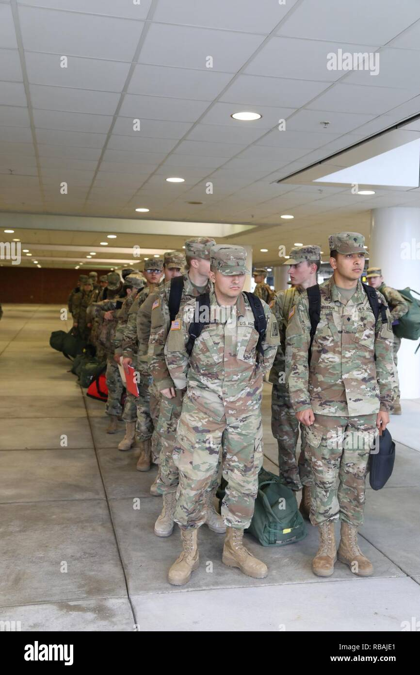 Ordnance advanced individual training (AIT) Soldiers stand in line Dec. 20, 2018 prior to check in for their flights from the Richmond International Airport. The node processed 2,000 Fort Lee, Va., Soldiers who were flying home for the holidays. The brigade processed more than 4,200 Soldiers leaving via POV, air, bus and train. Each year during the Christmas and New Year holiday season, U.S. Army Combined Arms Support Command AIT schools conduct HBL to give military students and cadre downtime. - Stock Image