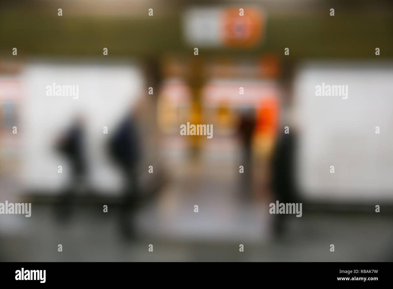 People on the subway station, blurred. Modern urban lifestyle, rush hour, stressful life, transition and passage abstract and concept. Stock Photo