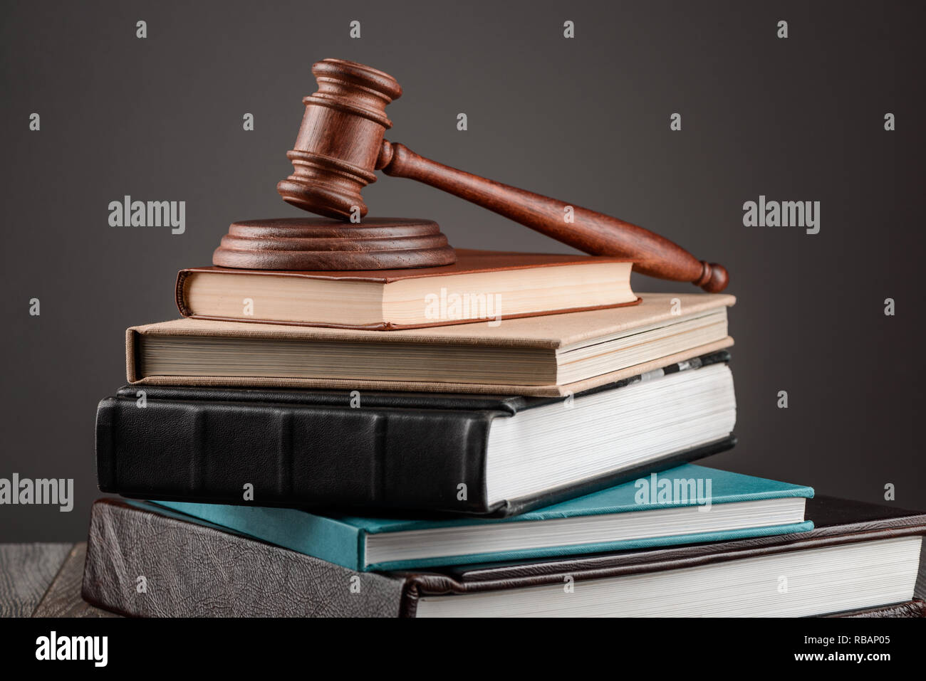 Pile of books and gavel - Stock Image