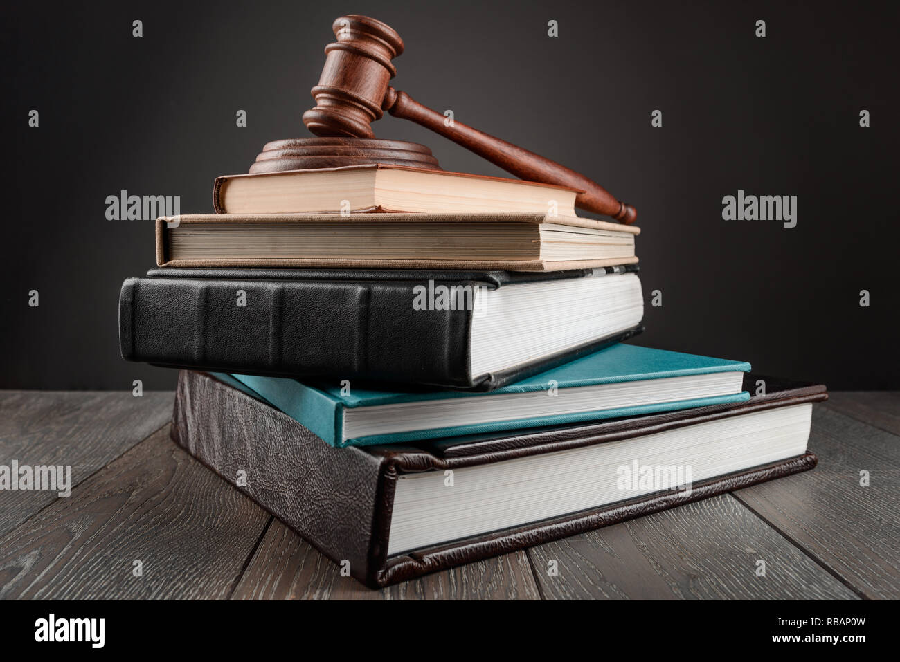 Gavel on top of books - Stock Image