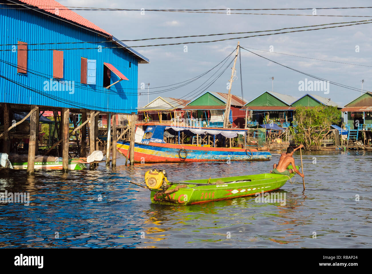 Houses on stilts and boats in floating village in Tonle Sap lake. Kampong Phluk, Siem Reap province, Cambodia, southeast Asia Stock Photo