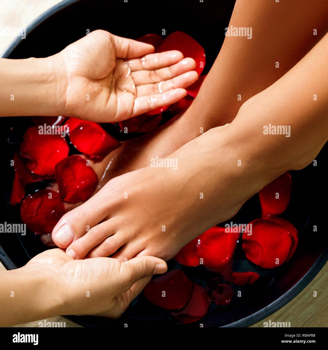 Baby Foot De Salon foot washing in the spa salon. legs massage concept. feet