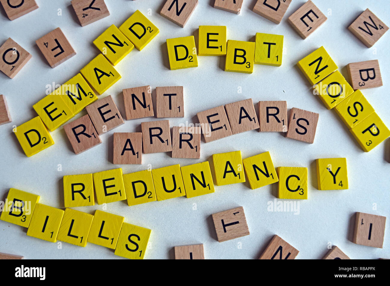 Rent Arrears, Debt, Bills, Final Demand, NOSP, CCJ, Court Action, losing job, unemployed, redundancy spelled out in letters - Stock Image