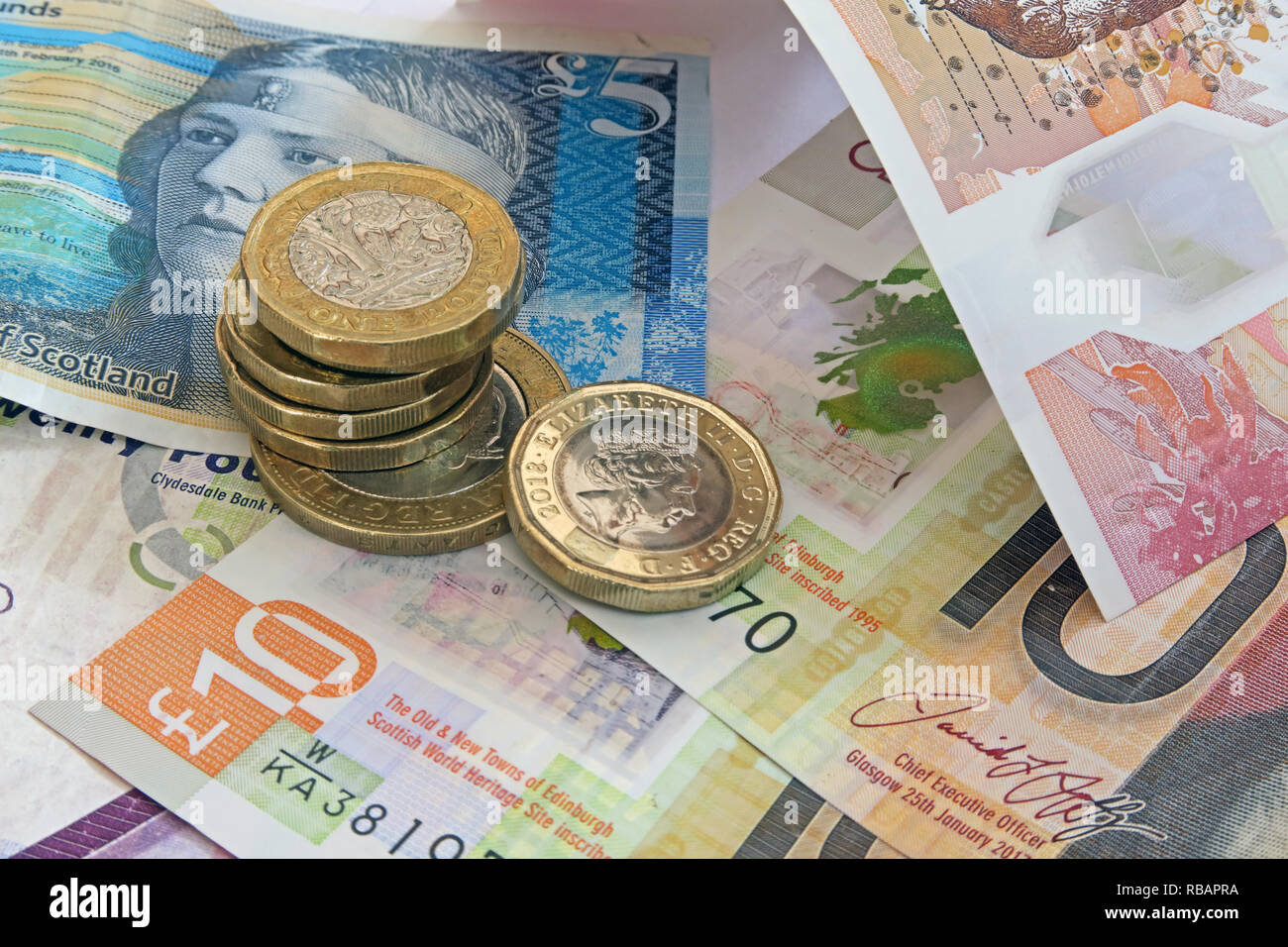 Bank Of Scotland, Clydesdale & RBS plastic £5 £10 Five pound and ten pound bank notes, with coins - Stock Image