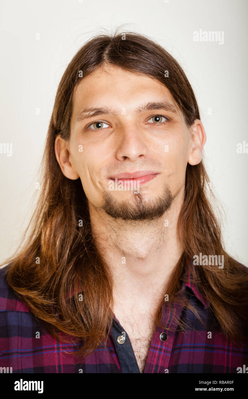021fde0e Masculinity concept. Smiling guy with long hairs. Young man in plaid shirt.