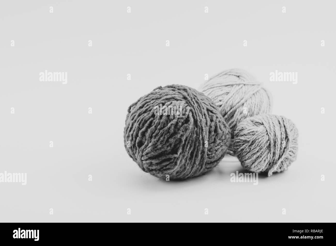 wool balls still life on a white surface - Stock Image